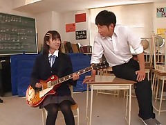 Pretty schoolgirl Asuka is in the classroom, learning to play the guitar. This bitch is more interested in her professor and he sees in her a lot of potential but not as a guitar player. She has a lot more talent when it's about a hard dick and gives him one hell of a hand job before bending over in front of him